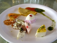 High tea [counter clockwise from far back near the sauce] - Moong Dal Chilla, Thaat Idli, Rabadi Malpua, assorted Sandesh