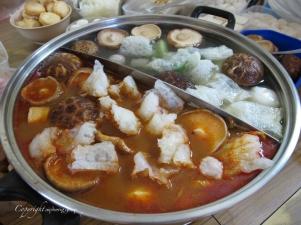 Steamboat   mushrooms, fish maw, abalone, scallops, prawns, fishballs, fish, vegetables, quail's eggs